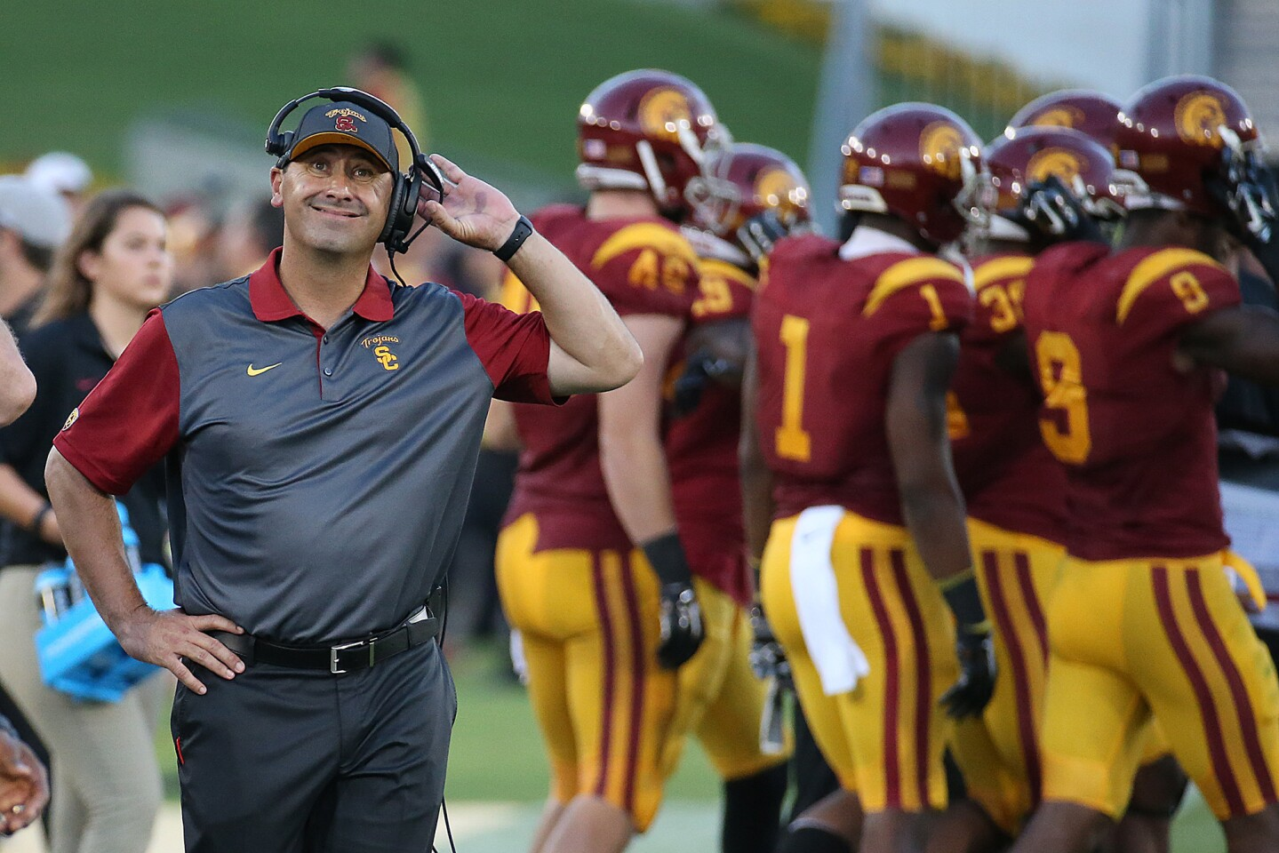 USC Coach Steve Sarkisian looks at the scoreboard after Stanford scored a touchdown on Sept. 19, 2015.