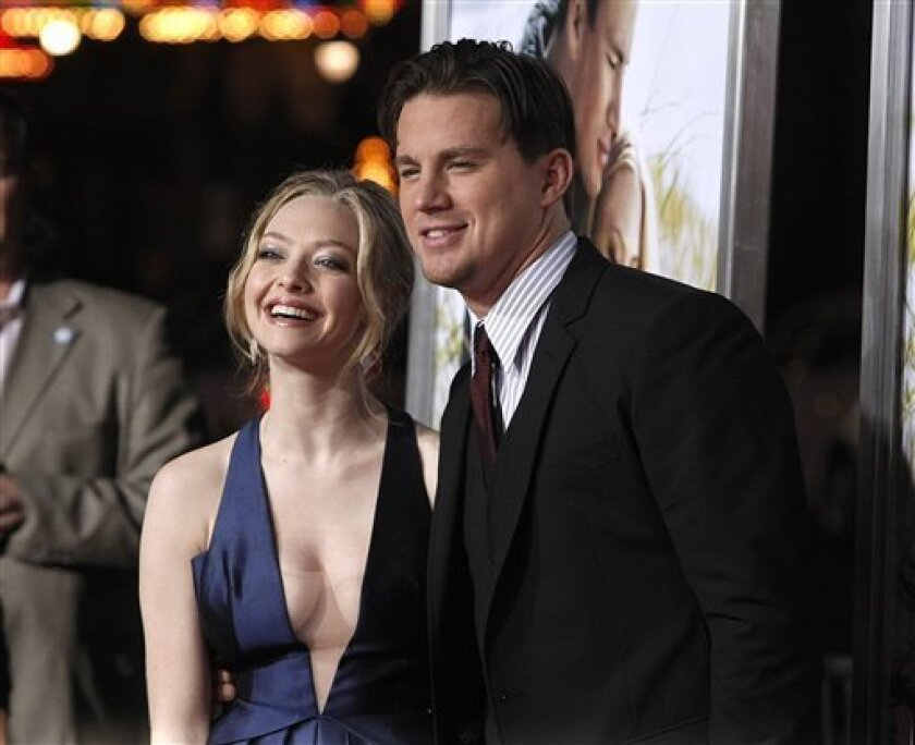 """FILE - In this Feb. 1, 2010 file photo, Actress Amanda Seyfried and Channing Tatum arrive at the premiere of the feature film """"Dear John"""" in Los Angeles. The science-fiction love story has given way to an earthbound romance at the weekend box office. """"Dear John"""" debuted as the No. 1 movie with $32.4 million, knocking off the blockbuster """"Avatar"""" after seven weekends in first place. (AP Photo/Dan Steinberg, File)"""