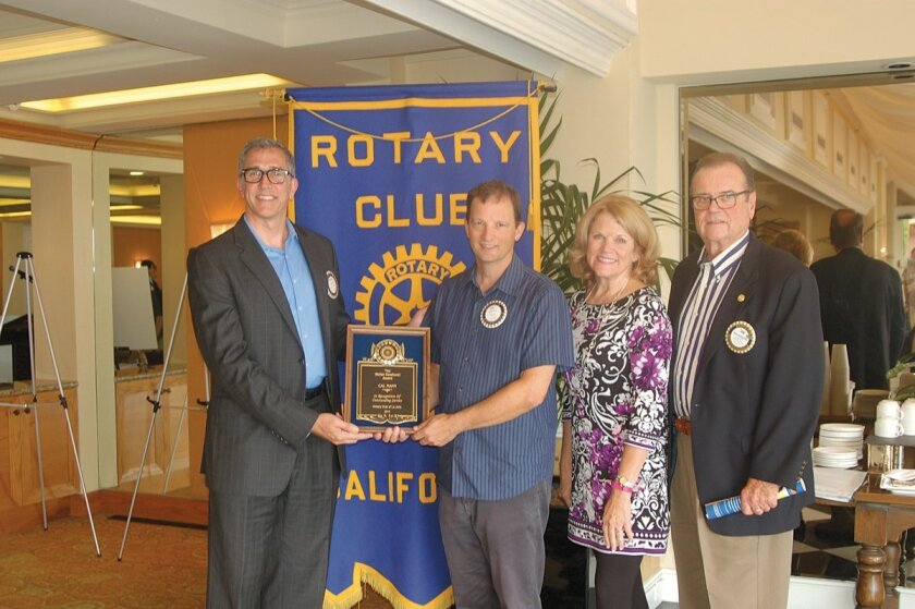 La Jolla Rotary Club president Russell King with Cal Mann, Patty Dewhurst and Don Dewhurst upon presentation of the Walter Dewhurst Award. Courtesy