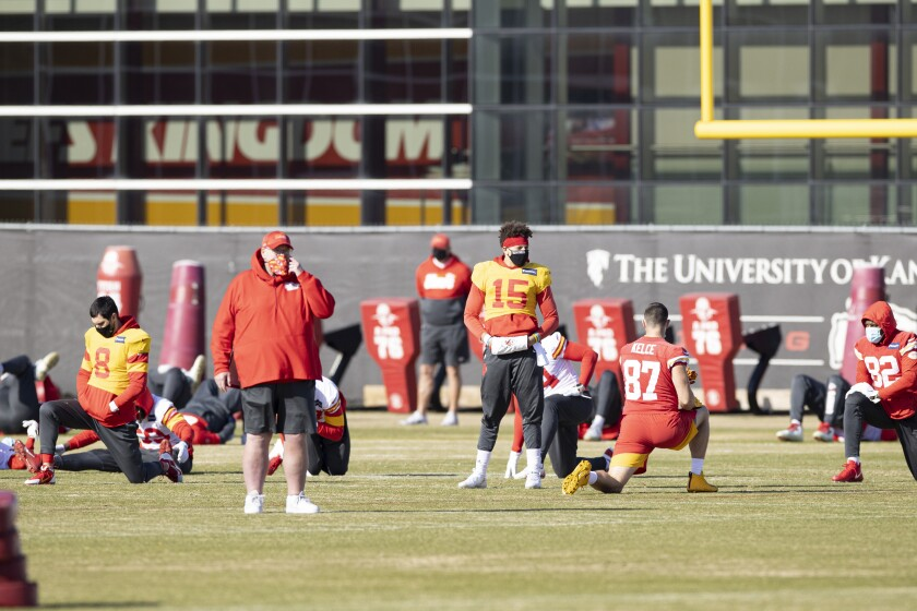 Kansas City Chiefs Head Coach Andy Reid and Quarterback Patrick Mahomes (15) look on during NFL football practice Wednesday February 2, 2021 in Kansas City, Mo. The Chiefs will face the Tampa Bay Buccaneers in Super Bowl 55. (Steve Sanders/Kansas City Chiefs via AP)