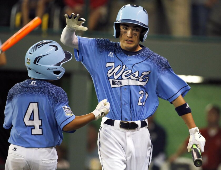 Sweetwater Valley's Jacob Baptista (23) celebrates with Cameron Barbabosa (4) after scoring on a hit by Dante Schmid during the first inning of a Little League World Series elimination game against Bowling Green East at the Little League World Series in South Williamsport, Pa., on Tuesday. (AP Photo/Gene J. Puskar)
