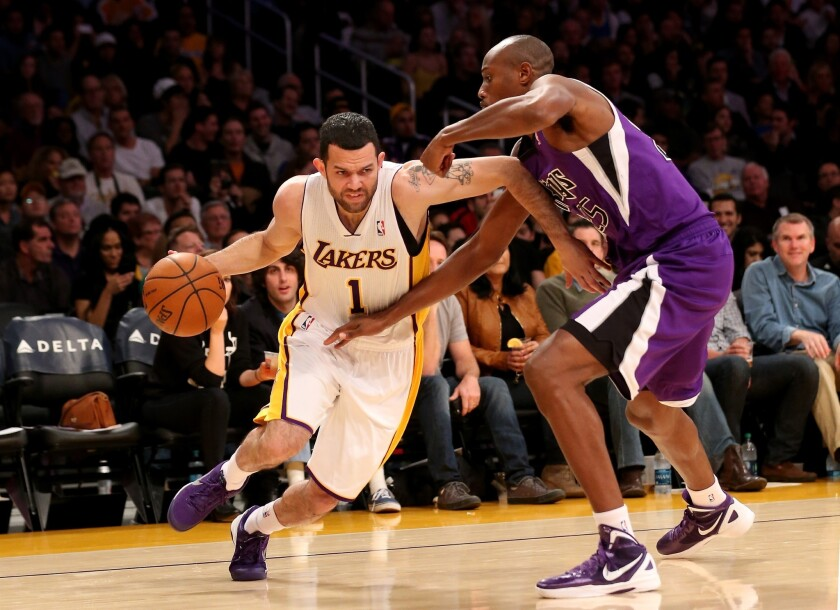 Lakers point guard Jordan Farmar, shown playing last week against the Sacramento Kings, is expected to be out approximately four weeks with a torn left hamstring.