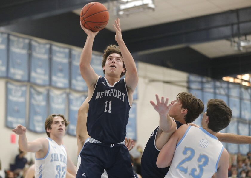 Newport Harbor's Levi Darrow makes a layup during the Battle of the Bay basketball game against Corona del Mar on Friday.