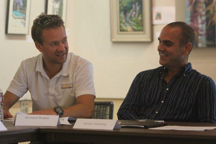 Design Division member Richard Walker (left) discusses Village planters as LJVMA vice-president James Neibling listens.