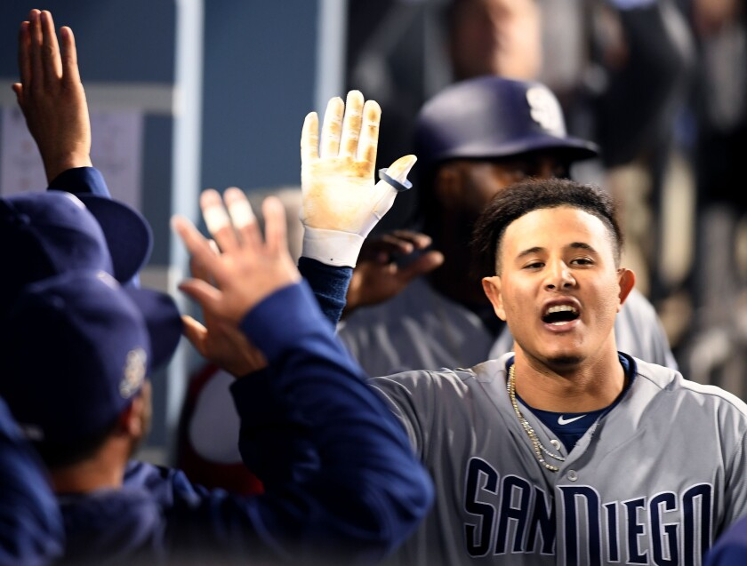 A viral video showing a verbal exchange Thursday  between Padres star Manny Machado (shown during a May 14 game at Dodger Stadium) and a Dodgers fan illustrated his commitment to change in San Diego.
