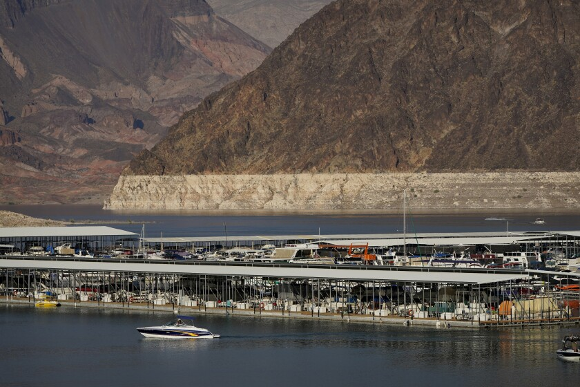 FILE - In this Aug. 13, 2020, file photo, a bathtub ring of light minerals delineates the high water mark on Lake Mead at the Lake Mead National Recreation Area near Boulder City, Nev. The U.S. Bureau of Reclamation released projections Wednesday, Sept. 22, 2021, that indicate an even more troubling outlook for a river that serves millions of people in the U.S. West. The agency recently declared the first-ever shortage on the Colorado River, which means Arizona, Nevada and Mexico won't get all the water they were allocated next year. (AP Photo/John Locher, File)
