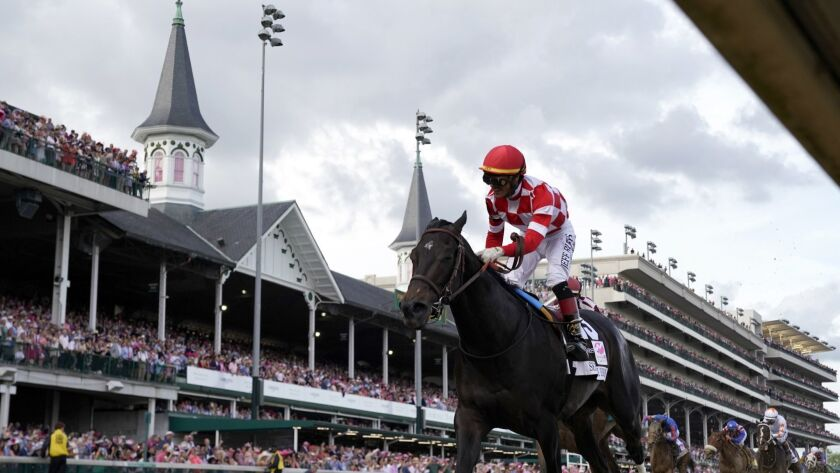 Jose Ortiz rides Serengeti Empress to victory during the 145th running of the Kentucky Oaks horse ra