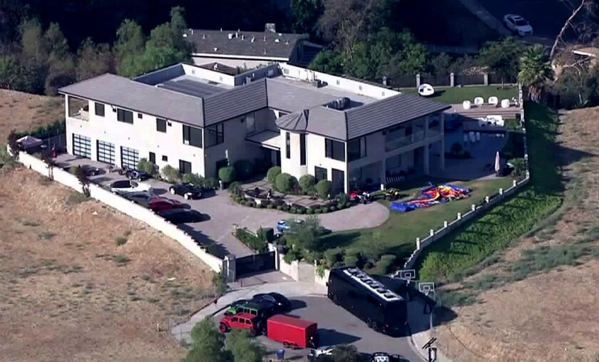 Chris Brown's Tarzana residence, where police stood for hours waiting for a search warrant after the singer refused to let them enter.