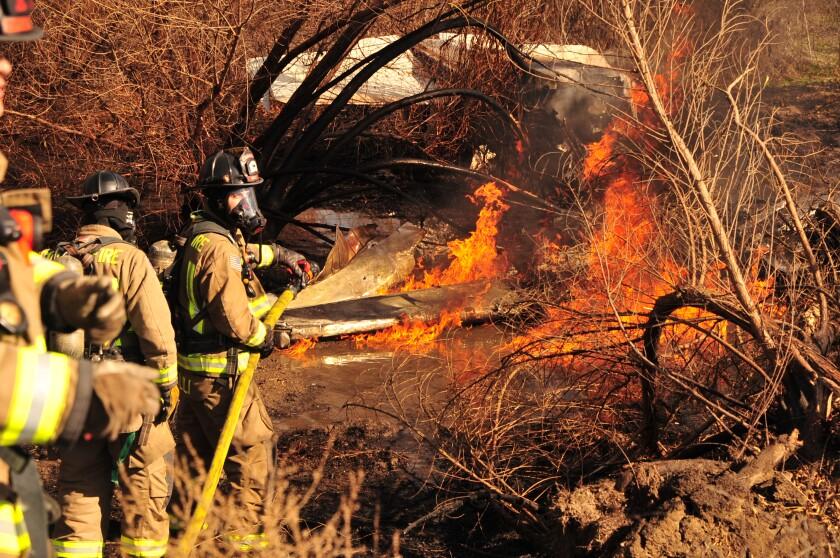 Coroner identifies 4 people killed in Corona plane crash