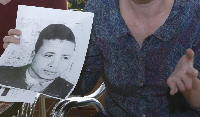 FILE - In this photo dated Thursday, Oct. 22, 2015 American lawyer, Cori Crider, shows a portrait of Younis Abdurrahman Chekkouri a former Guantanamo detainee released from the U.S. detention center, during a press conference held in Rabat, Morocco. Chekkouri has been held for more than six weeks w