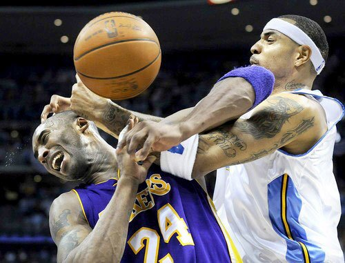 Lakers guard Kobe Bryant is fouled by Nuggets power forward Kenyon Martin late in the fourth quarter Saturday night. Bryant would finish with 41 points in the victory.