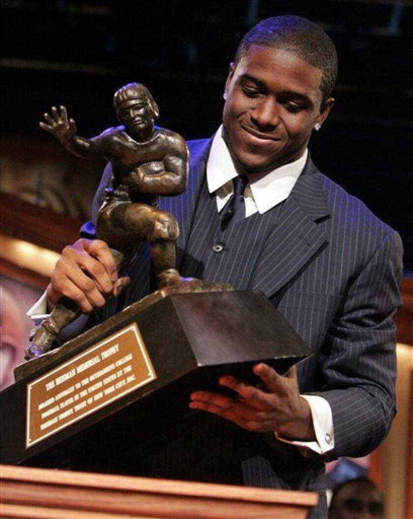 File -- In a Dec. 10, 2005 file photo Southern California tailback Reggie Bush picks up the Heisman Trophy after being announced as the winner of the award in New York. (AP Photo/Julie Jacobson, File)
