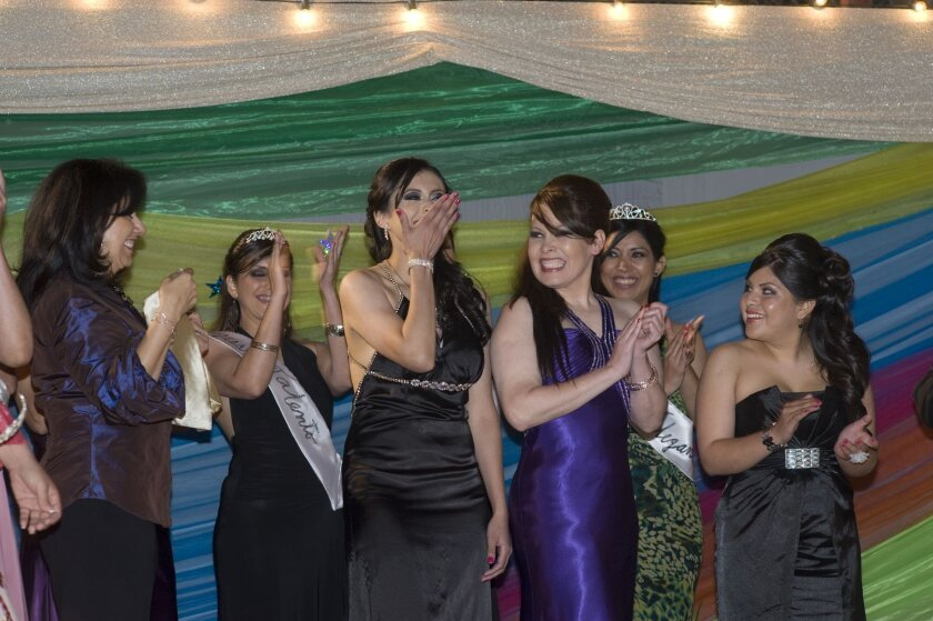 Gloria Vanessa Murrillo covers her mouth in disbelief after she was announced as first place winner of the competition.
