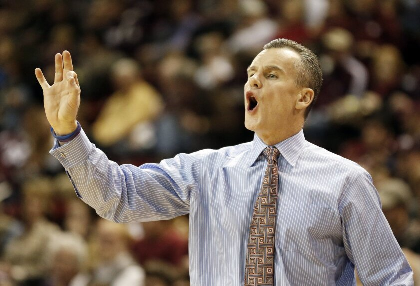 Florida coach Billy Donovan calls out to his team in the first half of an NCAA college basketball game against Mississippi State in Starkville, Miss., Thursday, Jan. 30, 2014. (AP Photo)