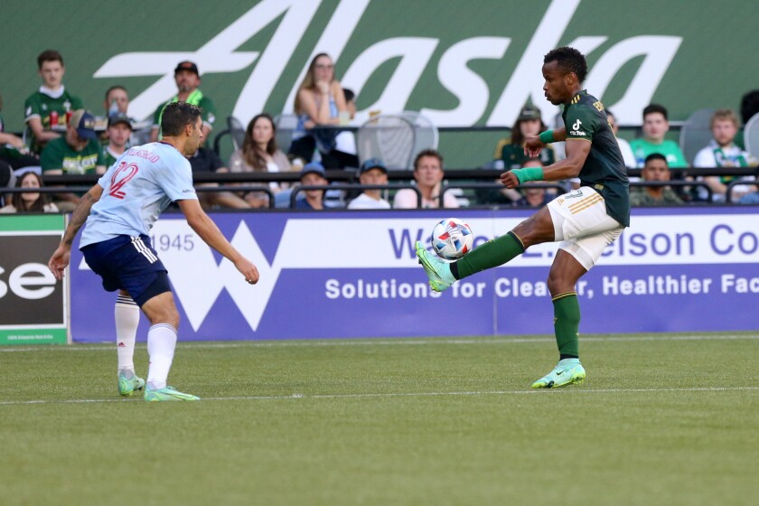 Portland Timbers forward Jeremy Ebobisse, right, balances the ball on his foot during an MLS match against FC Dallas, Saturday, July 17, 2021. (Sean Meagher/The Oregonian via AP)