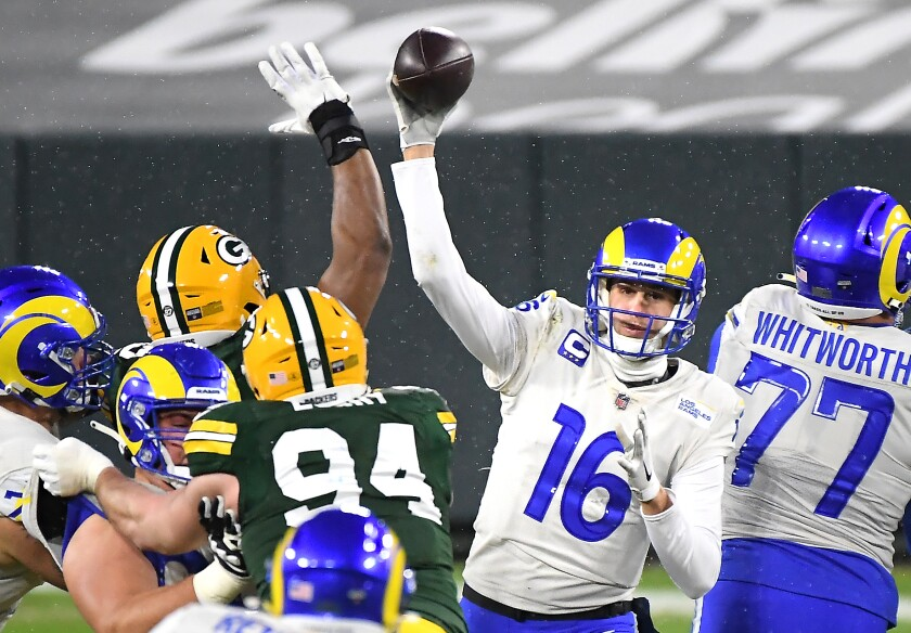 Rams quarterback Jared off gets a pass off against the Packers amid snow flurries at Lambeau Field.