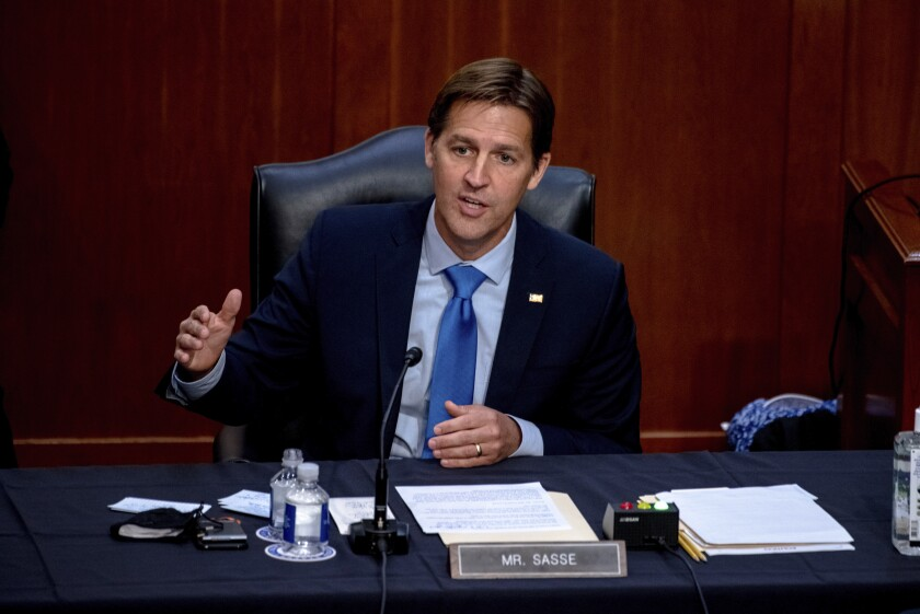 "FILE - In this Oct. 14, 2020 file photo, Sen. Ben Sasse, R-Neb., speaks during the confirmation hearing for Supreme Court nominee Amy Coney Barrett, before the Senate Judiciary Committee on Capitol Hill in Washington. Sen. Sasse told constituents in a telephone town hall meeting that President Donald Trump has ""flirted with white supremacists,"" mocks Christian evangelicals in private, and ""kisses dictators' butts."" (Hilary Swift/The New York Times via AP, Pool, File)"
