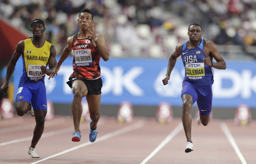 From right, Christian Coleman of the United States, Japan's Abdul Hakim Sani Brown and Barbados' Mario Burke compete during the men' 100 meters heats at the World Athletics Championships in Doha, Qatar, Friday, Sept. 27, 2019. (AP Photo/Petr David Josek)