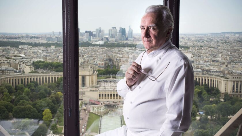 Chef Alain Ducasse poses in his restaurant Le Jules Verne at the Eiffel Tower in Paris on June 23, 2