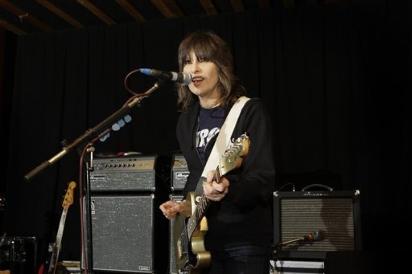 In this Jan. 22, 2009 file photo, singer Chrissie Hynde, lead singer of the Pretenders, during rehearsals at John Henry's Studio in north London. (AP Photo/Joel Ryan, file)