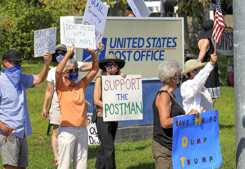 Protesters gathering in support of the USPS on Saturday near the Encinitas post office.