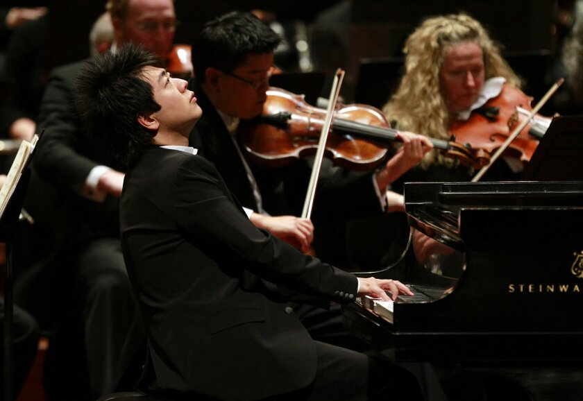 Lang Lang performs the Rachmaninoff Piano Concerto No. 2 with the San Diego Symphony to a sold-out Copley Symphony Hall Friday. K.C. ALFRED • U-T