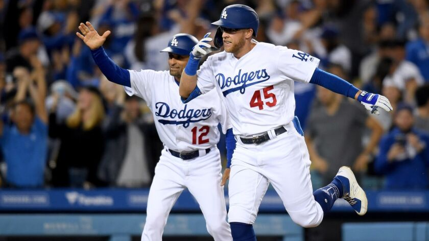 Matt Beaty celebrates with third base coach Dino Ebel after hitting a walk-off home run