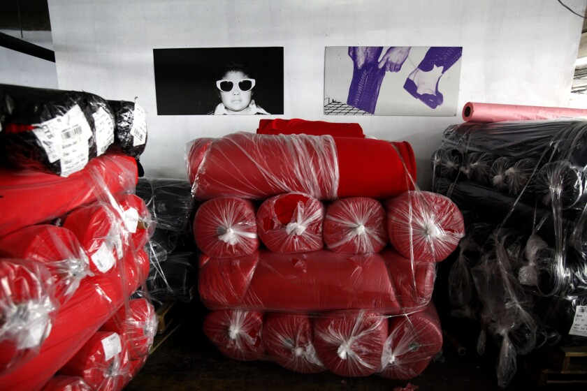 American Apparel agreed to pay $1 million to settle a civil lawsuit over a worker's death in 2011 after an accident involving a knitting machine. Above, packages of American Apparel garments.