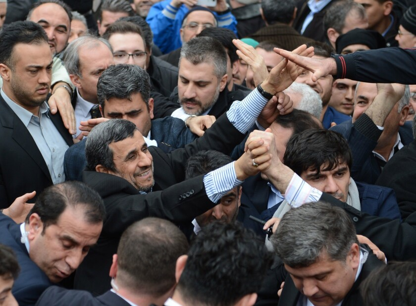 Former Iranian President Mahmoud Ahmadinejad among a crowd of men in Bursa