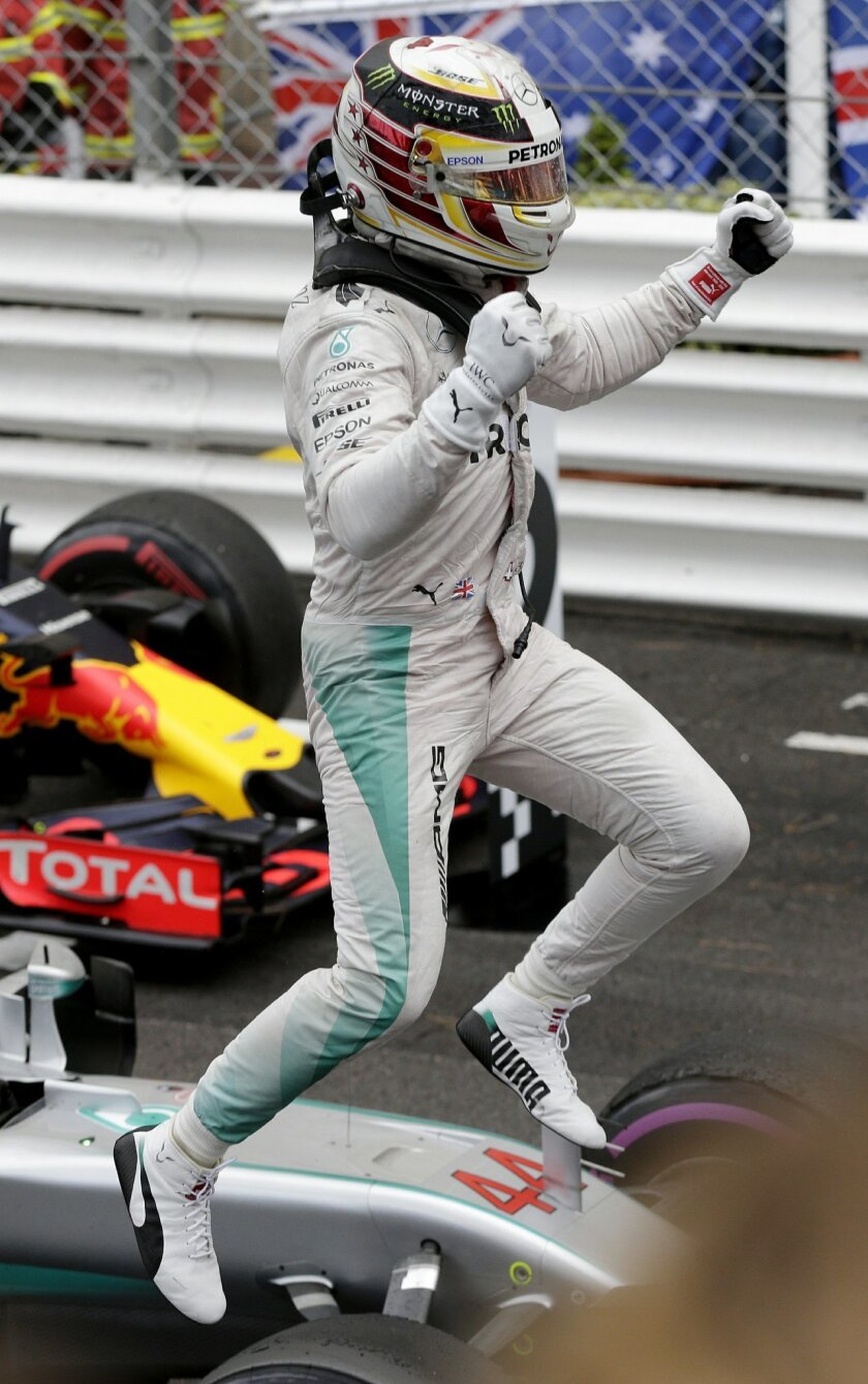 Mercedes driver Lewis Hamilton of Britain celebrates after winning the Formula One Grand Prix at the Monaco racetrack in Monaco, Sunday, May 29, 2016. (AP Photo/Petr David Josek)