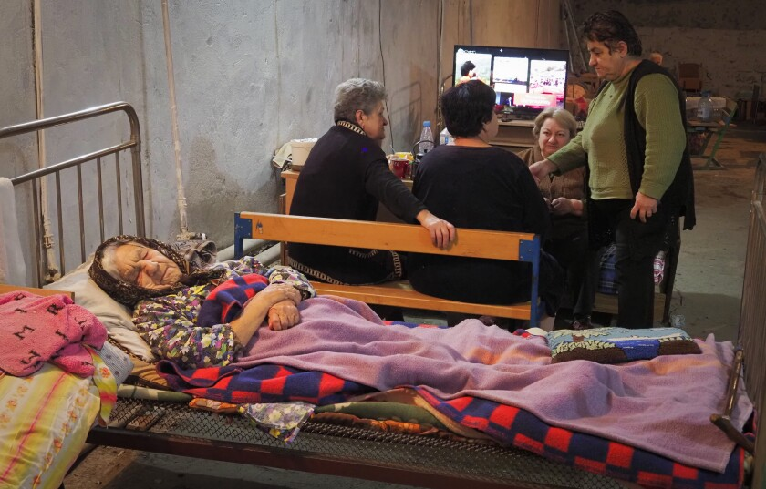 Women take refuge in a bomb shelter in Stepanakert, the separatist region of Nagorno-Karabakh, Sunday, Nov. 1, 2020. Fighting over the separatist territory of Nagorno-Karabakh entered sixth week on Sunday, with Armenian and Azerbaijani forces blaming each other for new attacks. (AP Photo)