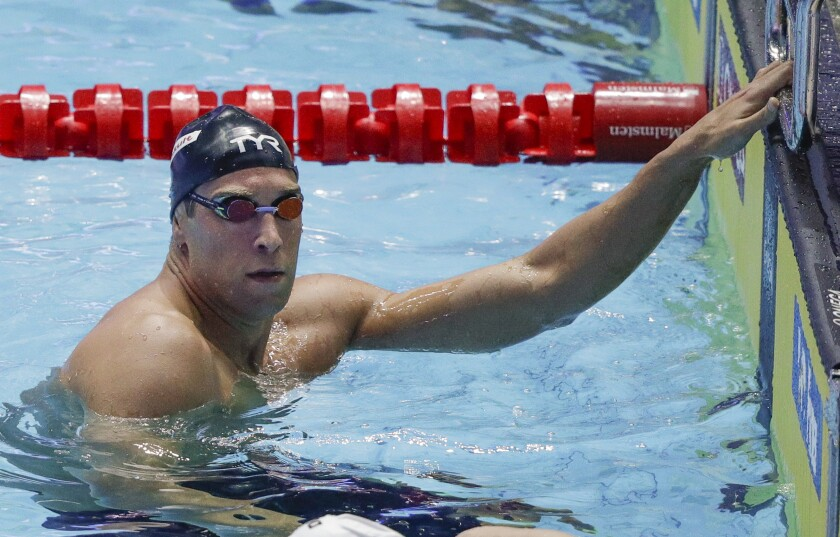 FILE - In this Monday, July 22, 2019 file photo, United States' Matt Grevers reacts after his swim in the men's 100m backstroke semifinal at the World Swimming Championships in Gwangju, South Korea. Grevers finished sixth in the 100-meter backstroke final at the U.S. Olympic trials on Tuesday night, June 15, 2021 dashing his bid for a third games. (AP Photo/Mark Schiefelbein, File)