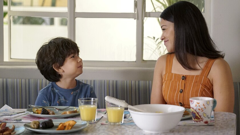 "Elias Janssen and Gina Rodriguez in ""Jane the Virgin"" on CW."