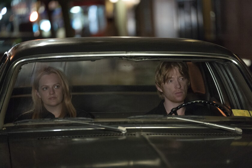 "Elisabeth Moss and Domhnall Gleeson in the movie ""The Kitchen."""