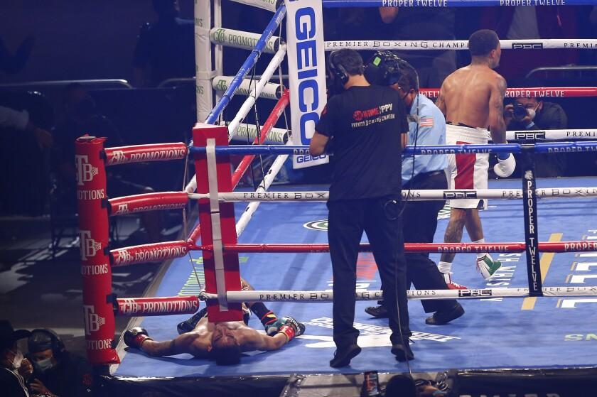 Gervonta Davis walks away after knocking out Leo Santa Cruz during the sixth round Oct. 31, 2020, in San Antonio.