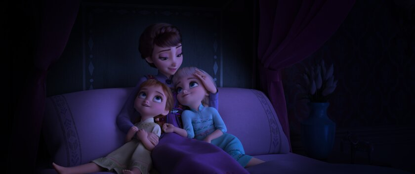 "Anna, left, and Elsa as little girls with Queen Iduna in ""Frozen 2."""