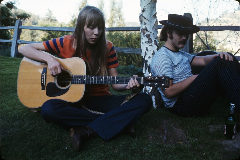 "Joni Mitchell and David Crosby are shown during a picnic at the Laurel Canyon home of Mama Cass of The Mamas & The Papas on Feb. 25, 1968. All three are interviewed in the absorbing new docu-series, ""Laurel Canyon,"" which debuts tonight on EPIX."