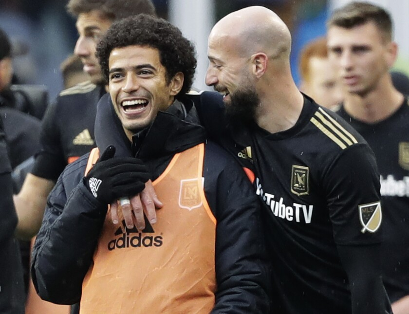 Los Angeles defender Laurent Ciman, right, celebrates with defender Omar Gaber after Los Angeles beat the Seattle Sounders 1-0 in an MLS soccer match, Sunday, March 4, 2018, in Seattle.
