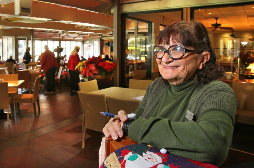 Adriene Edwards waits for customers at the Canyon Grille restaurant at the Welk Resorts San Diego in Escondido. She started working for the resort's original owner, television bandleader, in 1964 and is now in her 50th year with the company. Photos by Charlie Neuman/ U-T San Diego