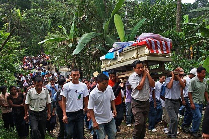 Mourners carry casket of Manuel Jaminez Xum in Guatemala in 2010