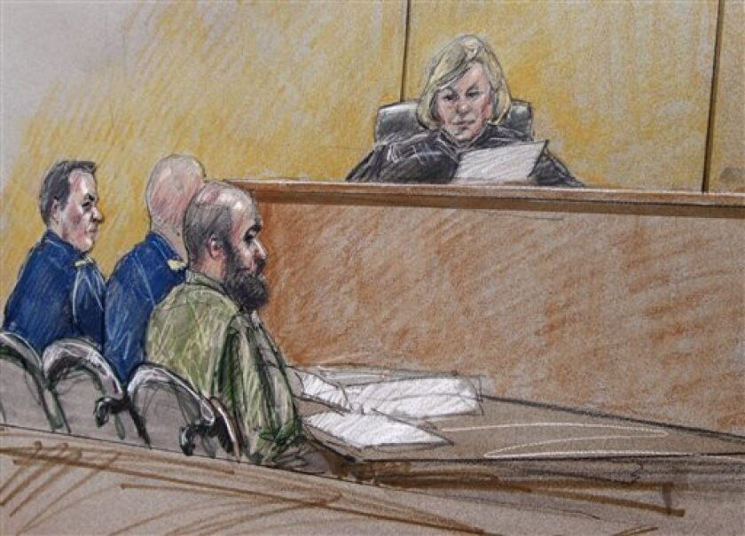 In this courtroom sketch, U.S. Army Maj. Nidal Hasan, right, sits by his former defense attorneys Maj. Joseph Marcee, far left, and Lt. Col. Kris Poppe, center, with Judge, Col. Tara Osborn, behind the bench during a pretrial hearing, Tuesday, July 9, 2013, in Fort Hood, Texas. Jury selection is set to start Tuesday in the long-awaited murder trial of Hasan, the Army psychiatrist accused of opening fire with a semi-automatic gun at Fort Hood nearly four years ago. (AP Photo/Tony Gutierrez)