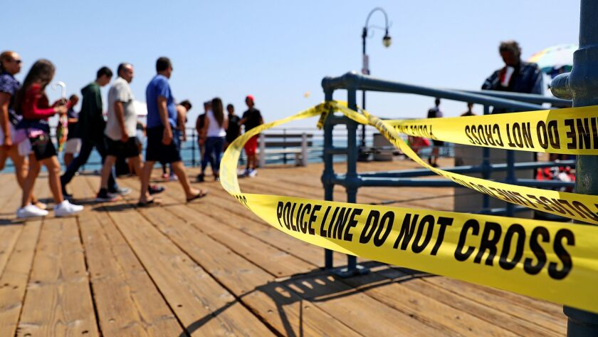 Police tape remains on the Santa Monica Pier near where a woman was shot Thursday morning.