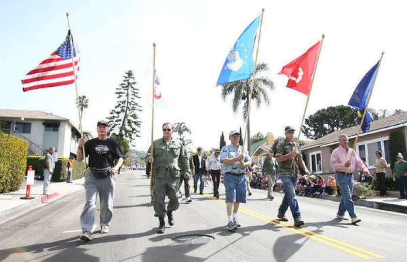 Members of the South Orange County Vietnam Veteran's group walk down Park Avenue in the 45th annual Laguna Beach Patriot's Day Parade Saturday.
