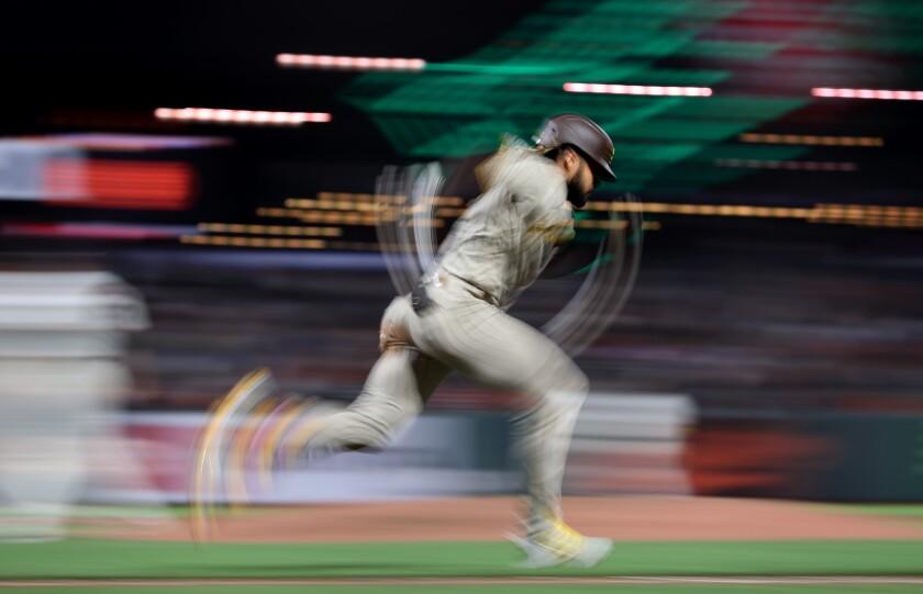 Fernando Tatis Jr. runs to first base against the San Francisco Giants