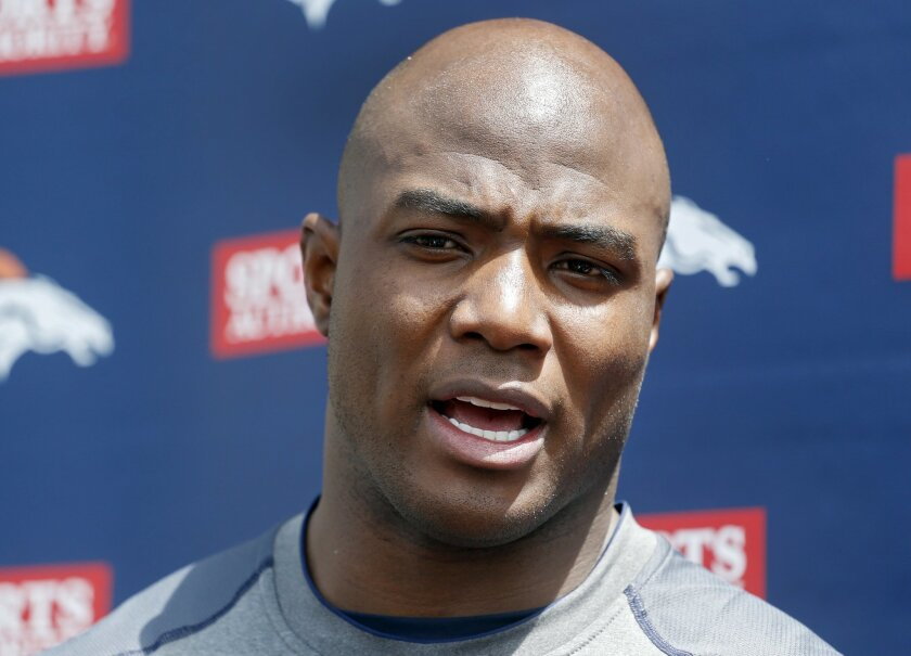 Denver Broncos defensive end DeMarcus Ware talks to the media after working out at the NFL football teams training facility in Englewood, Colo., on Monday, April 21, 2014. (AP Photo/Ed Andrieski)
