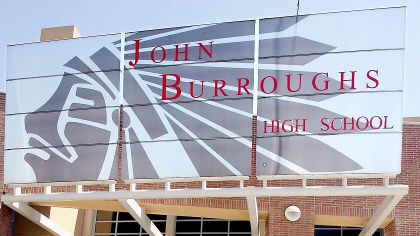 Students spill out of John Burroughs High School after the first day of school on Monday, August, 27