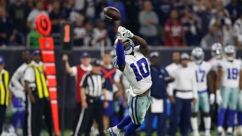 Cowboys receiver Tavon Austin reaches for a pass on October 7 against the Texans.