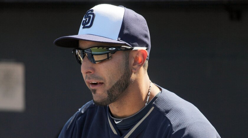 Padres outfielder Alex Castellanos sits in the dugout before the team's spring training game against the Indians in Peoria, Ariz. The Padres claimed Castellanos off waivers March 7.