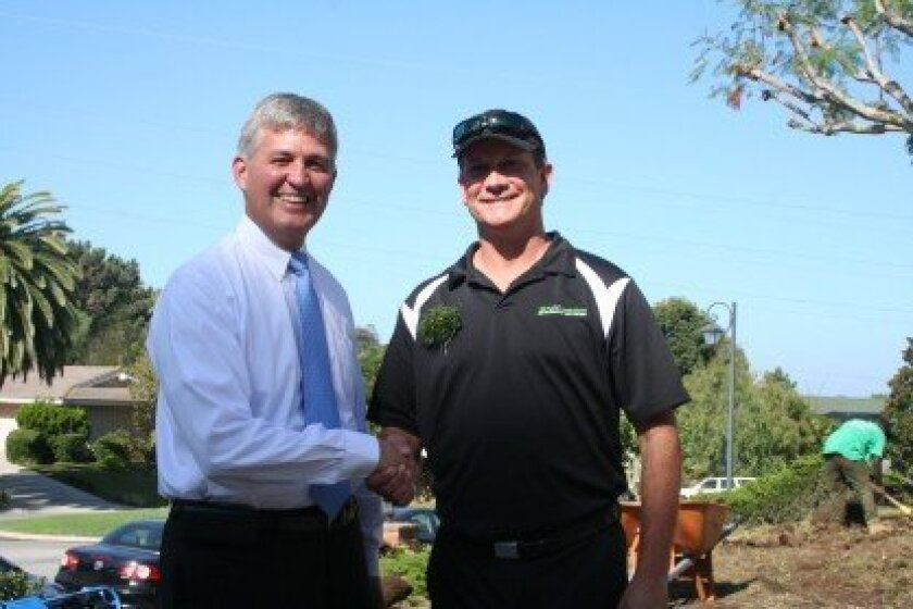 County Supervisor Dave Roberts and Turf Evolutions owner Shannon Beck.
