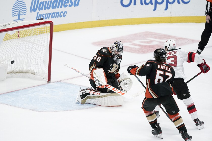 Devils center Nico Hischier (13) scores past Ducks goaltender John Gibson during the third period of the Ducks' 3-0 loss at Honda Center on Sunday.